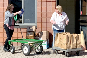 Two women with food bags (3/2020)