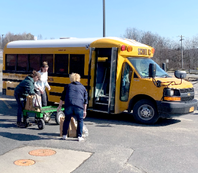 Three women and a school bus (10/2020)