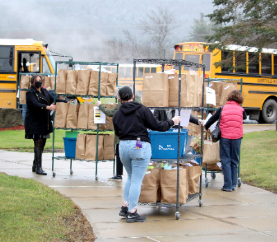 NHS students deliver for GMU families