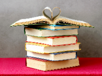Books in pile with heart pages (9/2020)